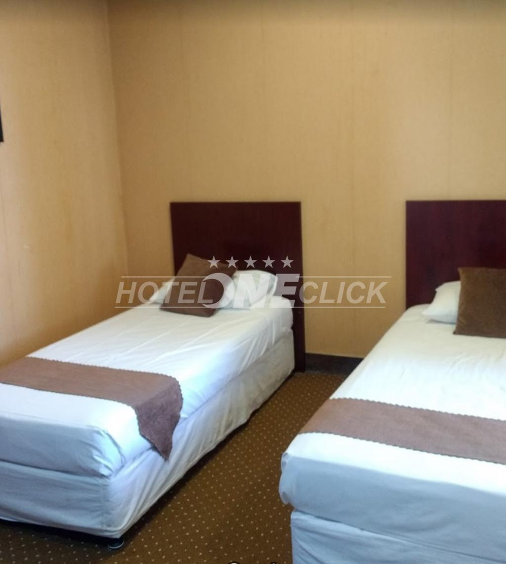 Aramesh Hotel clean and simple bedrooms in Kish